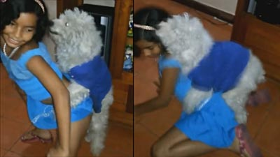 Young girl twerking with a dog